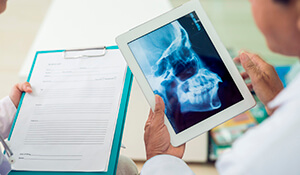 Dentists examining x-rays and patient charts